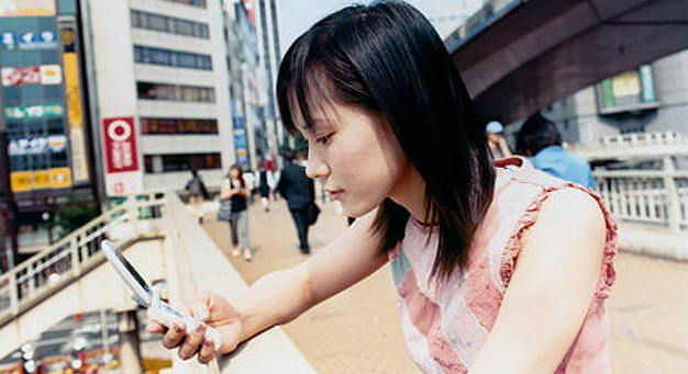 Cell phone user - Japan - woman