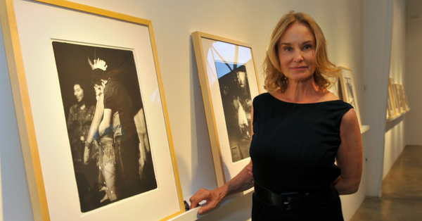 Jessica Lange poses with her photographs