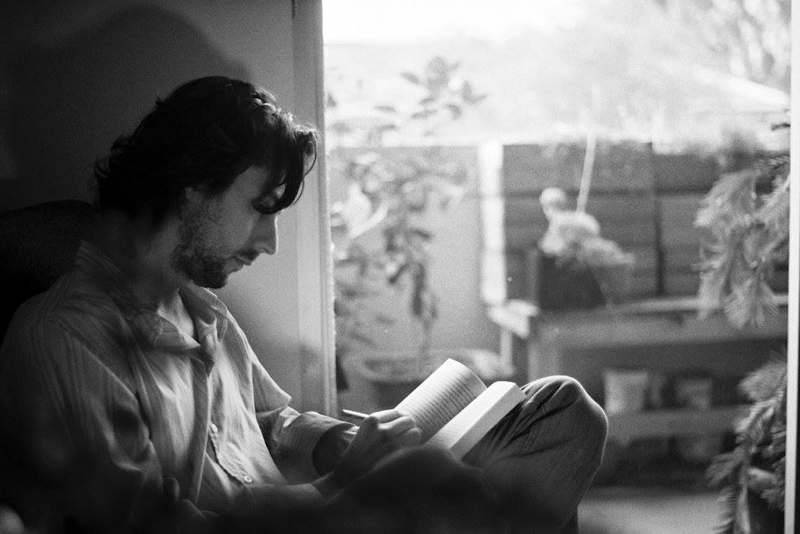 man reading from Janet Fitch Facebook page