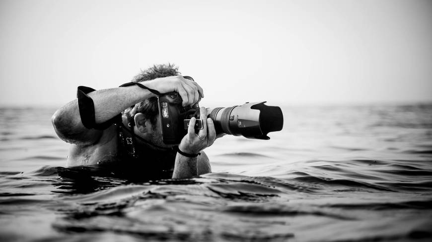 photographer in water from Facebook/CreativeLive