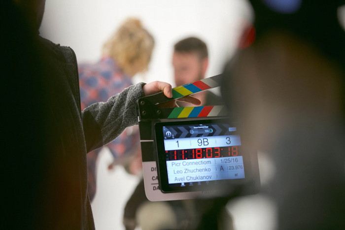 person holding clapperboard by Avel Chuklanov (from unsplash)